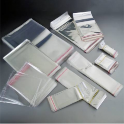 Portapenna con chiusura a clip, in plastica con filo estraibile 60cm e c/moschettone (rosso) e penna (rossa)
